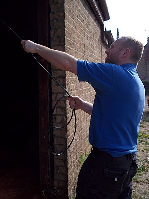 One of our qualified electricians pulling cable